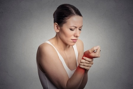 Woman holding her wrist